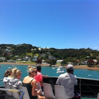 Enjoying a boat cruise in the Bay of Islands with Explore NZ